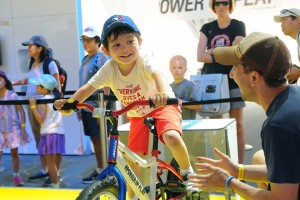boy on ecocharger at the pan am games